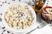 Penne pasta with mushroom and basil — Stock Photo