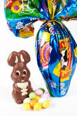Easter bunny made of chocolate with easter egg — Stock Photo