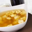 Broth with ravioli — Stock Photo