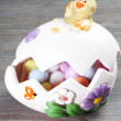 Stock Photo: Colorfull eggs in egg shaped eith chick
