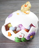 Colorfull eggs in the egg shaped eith chick — Stock Photo