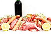 Verscheidenheid vlees op een witte achtergrond — Stockfoto