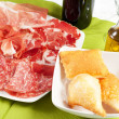 Pancakes with ham and meat products — Stock Photo