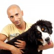 Man with puppy bernese mountain dog — Stock Photo