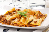 Pasta with meat sauce and bechamel in the dish on the table — Stock Photo