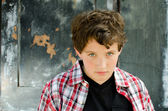 Young boy looking up at the audience. — Stock Photo
