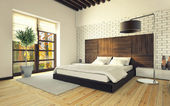 Bedroom with brick wall — Stock Photo
