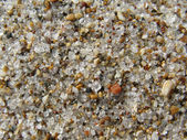 Colored sand on a beach — Stock Photo