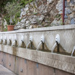 Fountain with lion heads — Stock Photo