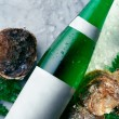 Bottle of White Wine and Fresh Oysters — Stock Photo
