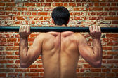 Crossfitter Training in the Gym with an Axle Bar — Stock Photo