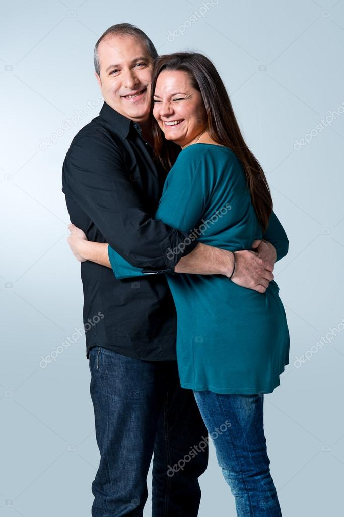 Happy Mature Couple Over a Blue Background — Stock Photo #20948121