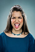 Cute Teenager Sticking out Tongue — Stock Photo