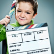 Royalty-Free Stock Photo: Little Actor with a Slate in His Head