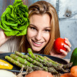 Stock Photo: Young WomPlaying with Veggies