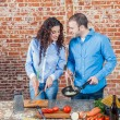 Royalty-Free Stock Photo: Young Loving Couple in the Kitchen