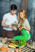 Young Couple Surfing the Web in the Kitchen — Stock Photo