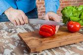Man Cutting Tomatoes — Stock Photo