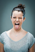 Young Happy Woman Sticking Out Her Tongue — Stock Photo