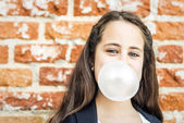 Little Happy Girl Blowing a Chewing Gum — Stock Photo