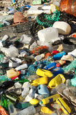 Garbage and wastes on a beach — Stock Photo