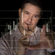 Young man as a trader measures fingers candle stick graph to analyze stock — Stock Photo #19020795
