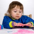Little girl stare with astonishment at color fingers — Stock Photo #23566809