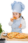 Little girl eating a pizza with salami and vegetables — Stock Photo
