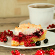 Piece of berry pie and cap of tea — Stock Photo