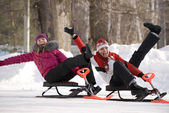 Two young girls having fun in wintry park — Stock Photo