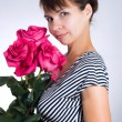 Young woman with three roses — Stock Photo