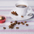 Cup of coffee decorated beans and star anise — Stock Photo