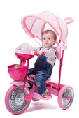 Little girl riding the children trike — Zdjęcie stockowe