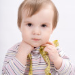 Adorable baby girl with a measuring tape in hands — Stock Photo #46899857