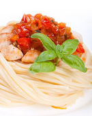 Chicken in sweet and sour sauce with pineapple and pasta — Stock Photo