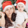 Mom and kid at Christmas tree. — Stock Photo #49170487