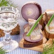 The pieces of salted herring decorated fresh green and the glass — Stock Photo #49170495