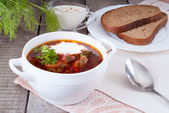 Borsch, soup from a beet, meat and cabbage with tomato sauce — Stock Photo