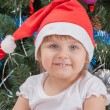 Portrait of happy cute little girl in red Santa hat — Stock Photo #51299273