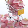 Shopping cart with pink roses — Stock Photo