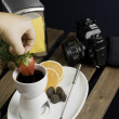 Dipping strawberry to hot fondue — Stock Photo