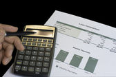 Loan comparison, data sheets, calculator and pen — Stock Photo