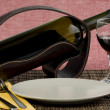 Photo: Bottle of wine, glass and plate
