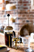 French press coffee and glass of water — Stock Photo