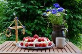 Made table at midsummer — Stock Photo