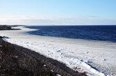 Coastline with ice belt — Stock Photo