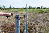 Loosen electric fence — Stock Photo