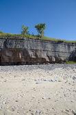 Limestone cliffs at the beach — ストック写真