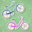Bicycles with rainbow wheels — Stock Vector