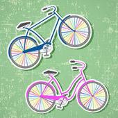 Fahrräder mit regenbogen-räder — Stockvektor